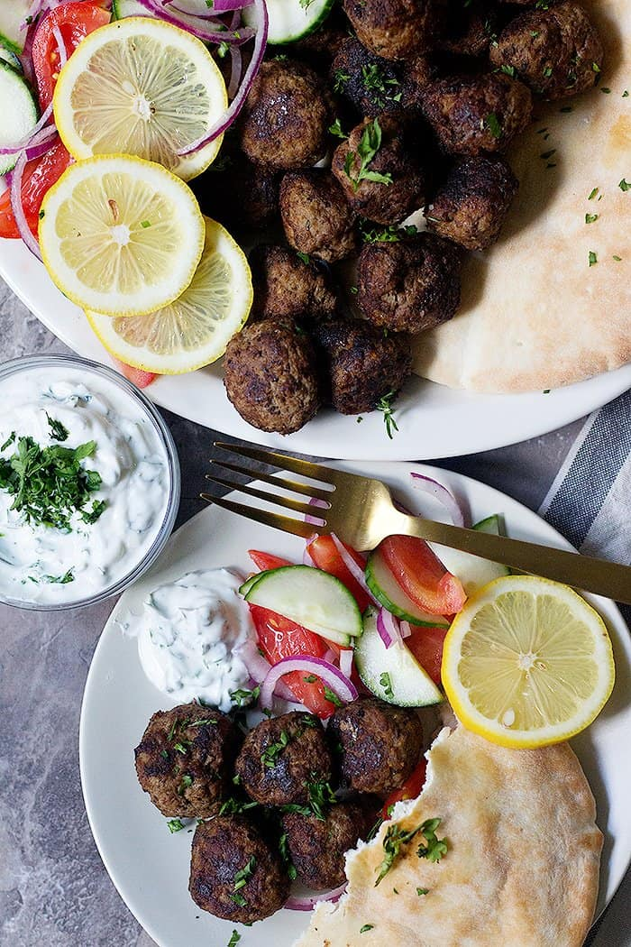 These Greek meatballs are the best meatballs ever! You can serve these delicious Greek meatballs as a crowd pleasing appetizer or a complete meal.