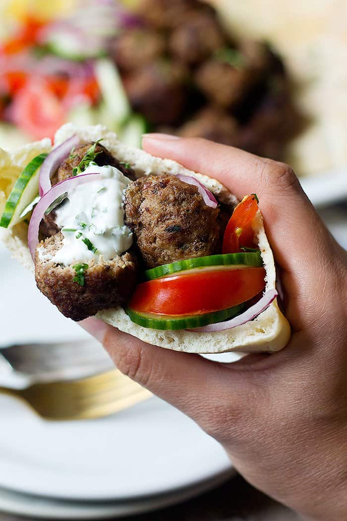 You can have keftedes with tomato, cucumber, onion and tzatziki.
