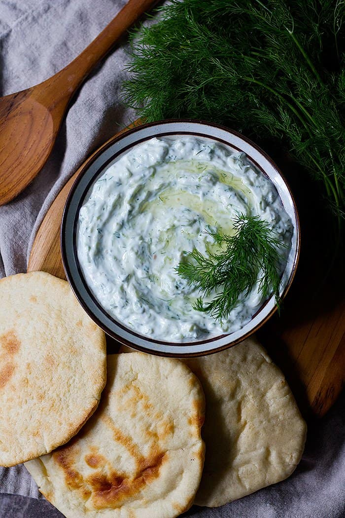 Tzatziki is flavored with garlic so please be generous with the garlic. Mix well and taste to make sure it has enough salt and acidity. Serve Greek tzatziki sauce cold.