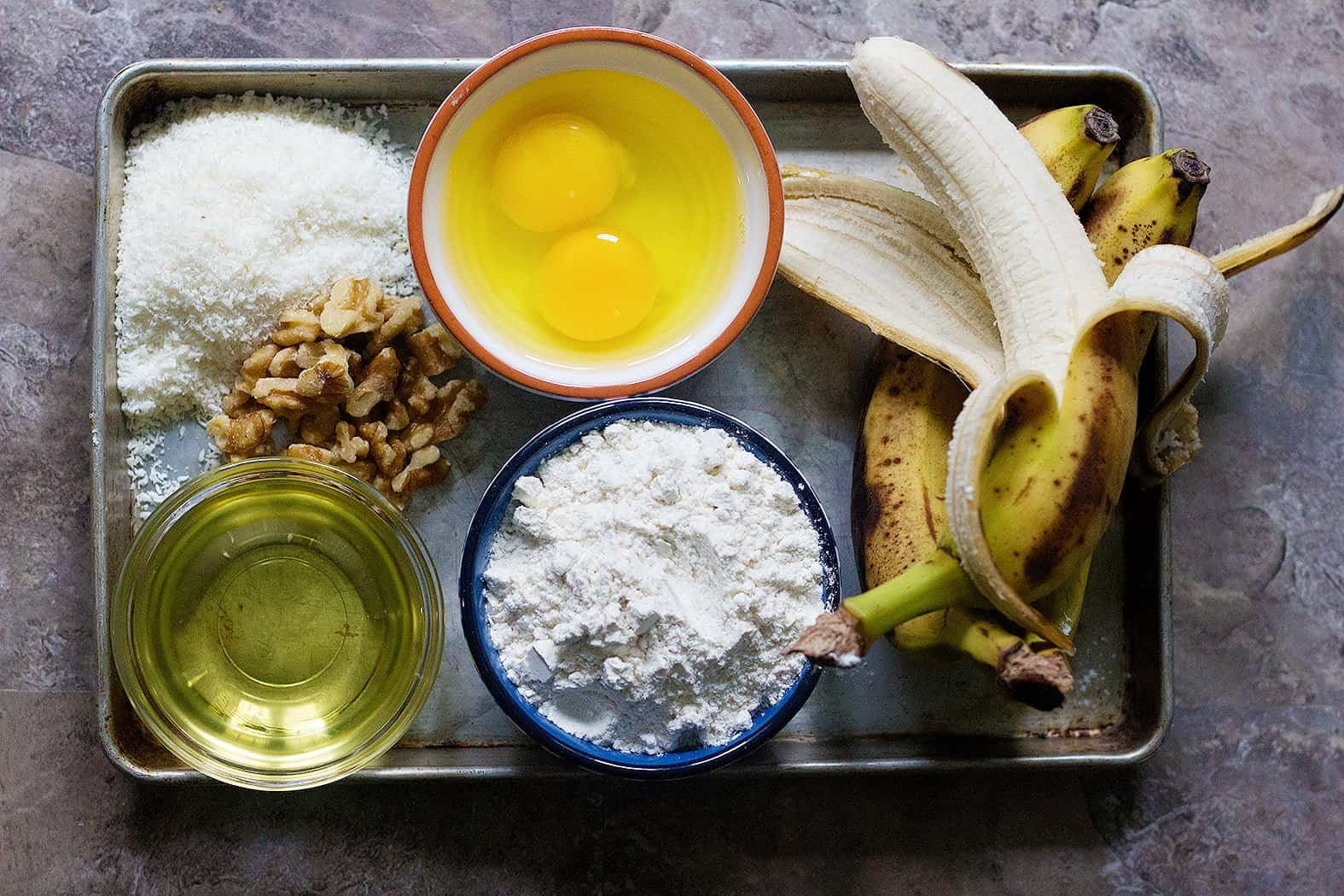 To make banana coconut bread you need bananas, eggs, coconut, flour, walnuts and vegetable oil.
