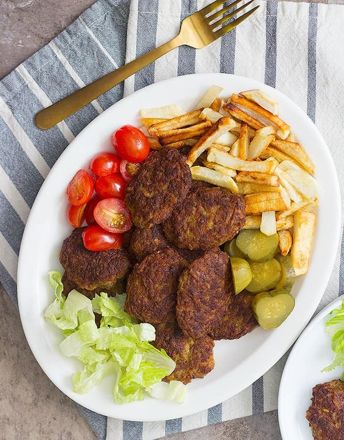 Serve kotlet with French fries, tomatoes and pickles.