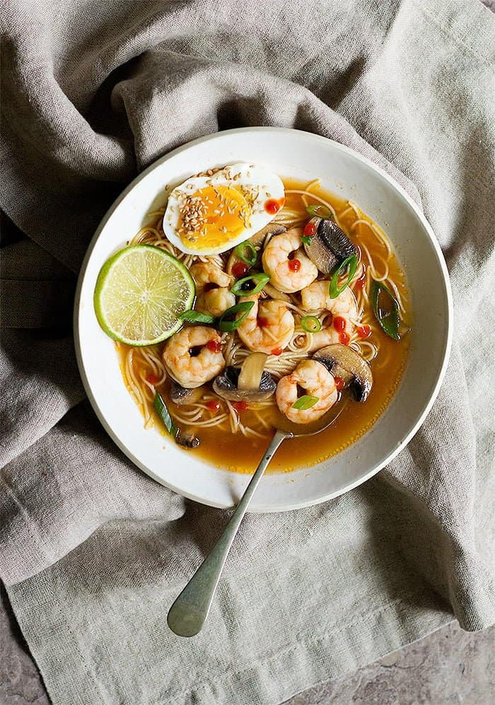 overhead shot of spicy ramen with shrimp and eggs.