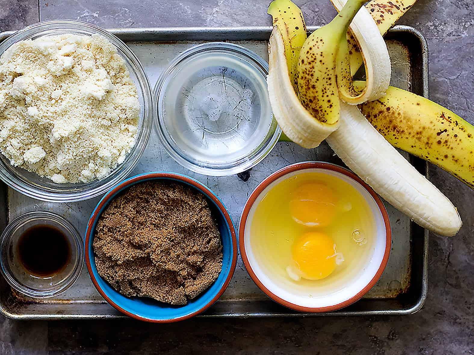 To make almond flour banana bread you need almond flour, coconut oil, bananas, eggs, brown sugar and vanilla.