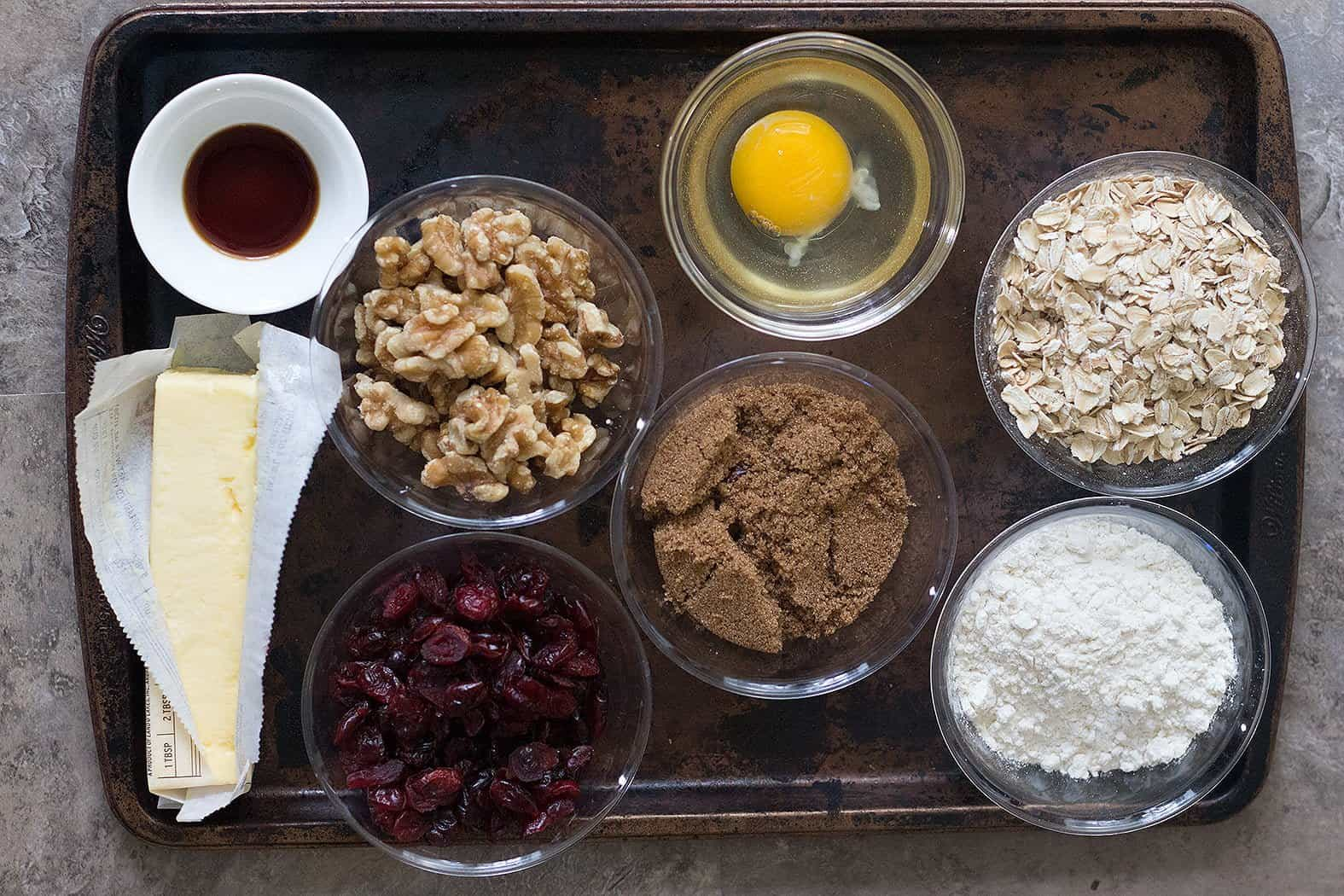 To make cranberry walnut oatmeal cookies you need butter, sugar, brown sugar, egg, vanilla, oatmeal, flour, cranberries and walnuts.