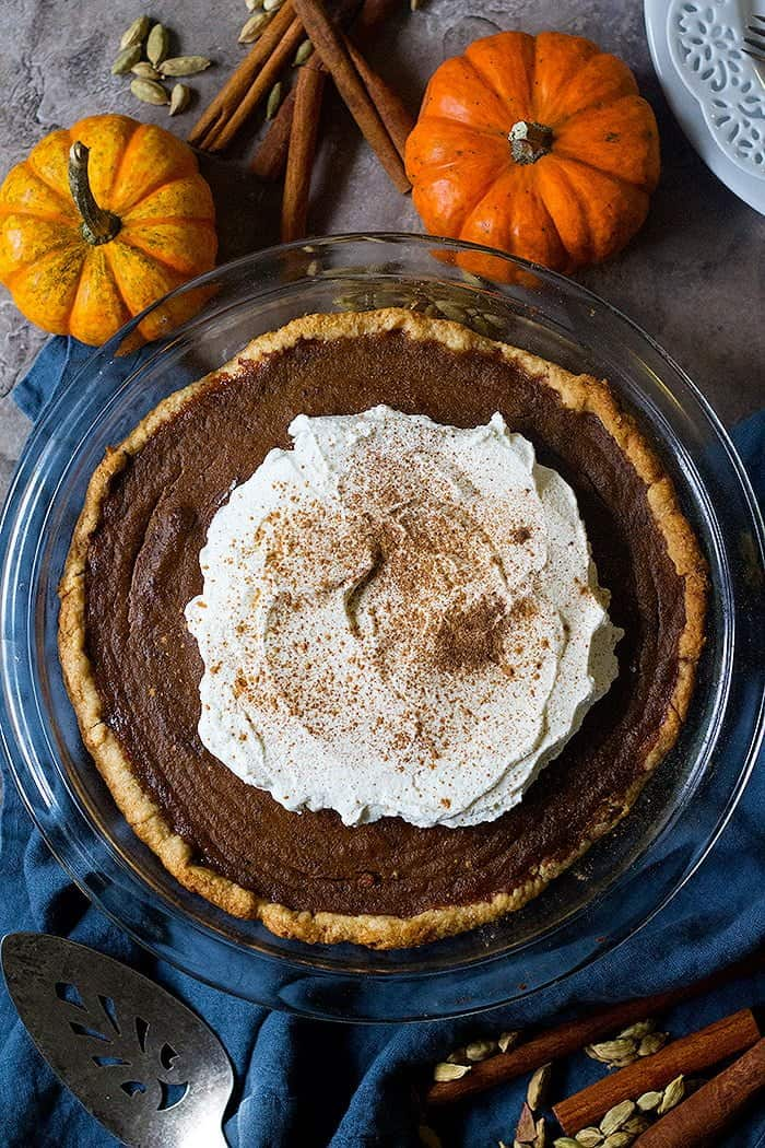 Learn how to make the best ever homemade pumpkin pie flavored with aromatic chai spices. This easy pumpkin pie is perfect for the Holidays.