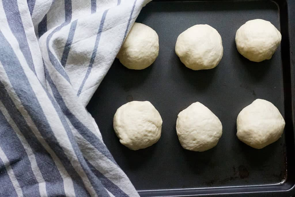 Deflate the dough gently and divide into 8 pieces. Shape each piece into a ball.