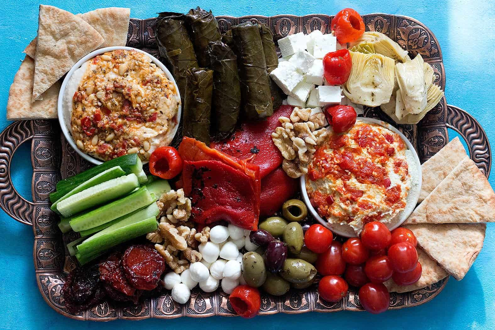 Add stuffed grape leaves, sun dried tomatoes, artichokes and olives to the Lebanese mezze platter.
