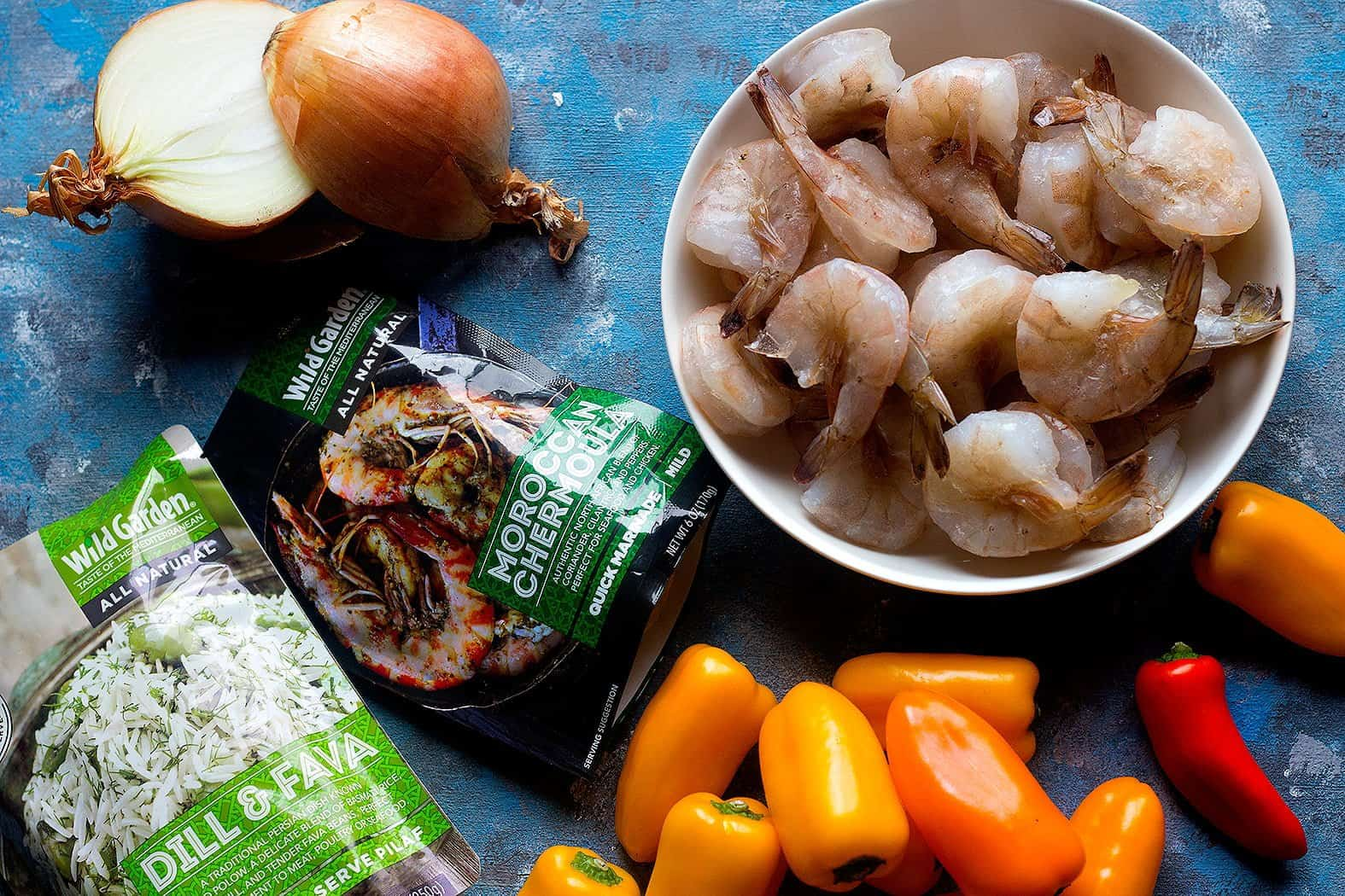 To make baked shrimp with chermoula sauce you need the following ingredients: Shrimp:It's best to use raw, deveined and peeled shrimp. You can leave the tail on or take it off as well. Onion:A bed of sliced onion is perfect for this dish. Peppers Chermoula sauce:this sauce gives so much flavor to the shrimps and onions. And since the sauce contains sunflower oil, there is no need for melted butter.