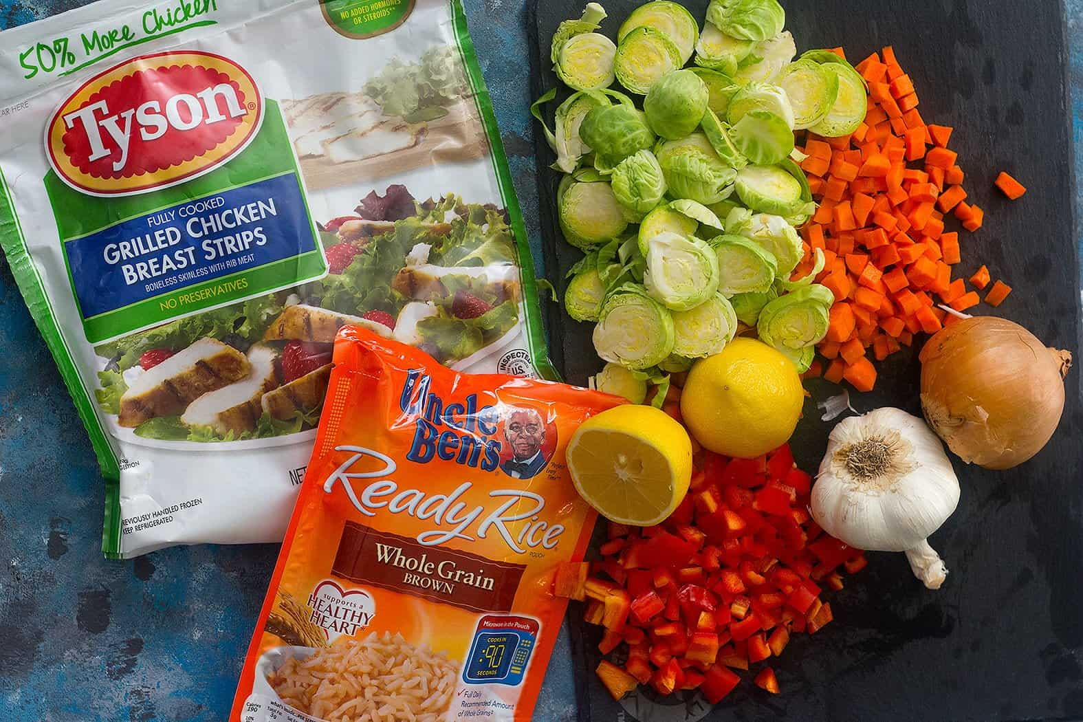 To make this easy skillet dinner, you need olive oil, onion, red bell pepper, carrots, garlic, brussels sprouts and spices, plus Tyson® Fully Cooked Refrigerated Grilled Chicken Breast Strips and Uncle Ben's® Ready Rice® Whole Grain Brown.