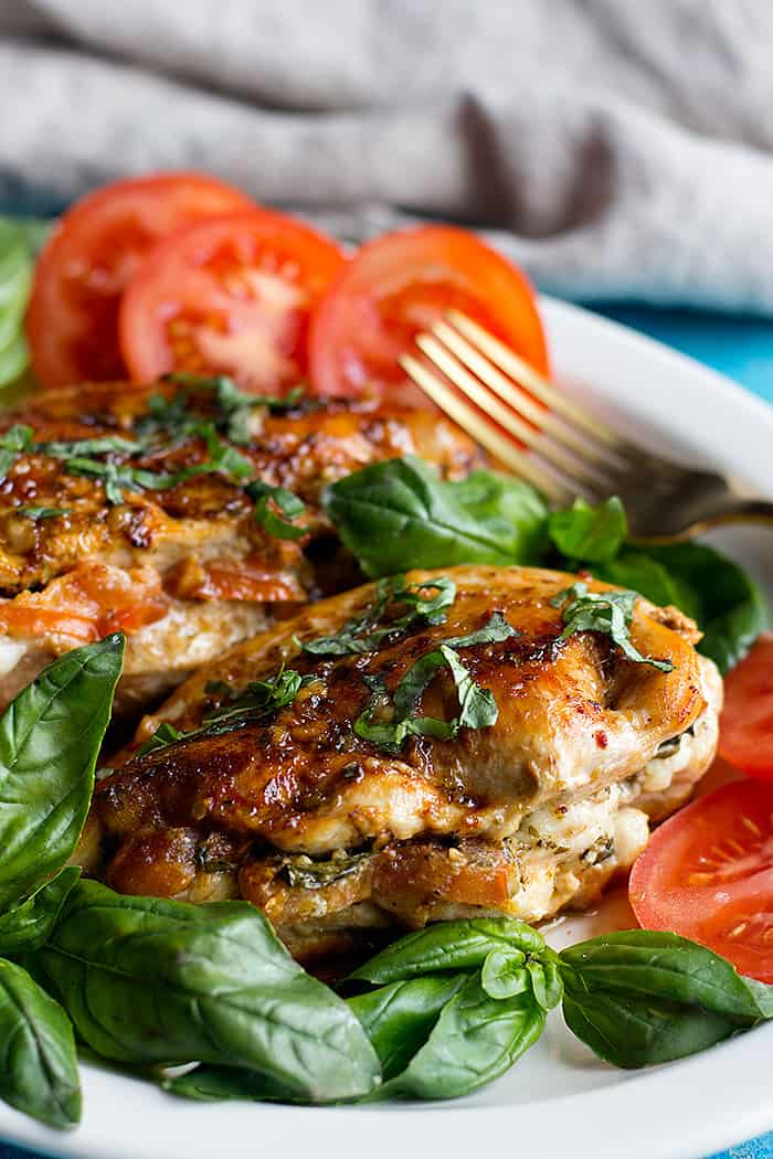 Caprese stuffed chicken breast is easy and packed with flavor. Juicy chicken breast stuffed with cheese, tomatoes and basil makes a delicious meal.
