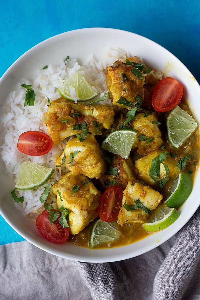 This fish curry with coconut milk is an easy dish packed with flavor. Flaky and tender Alaska cod simmered in a delicious onion and tomato curry sauce makes a perfect meal.