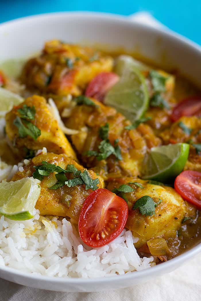 top fish curry with tomatoes lime and cilantro