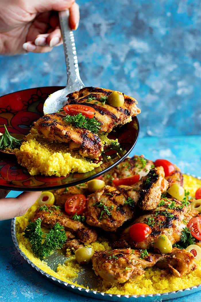 This delicious harissa chicken is the perfect weeknight meal served with saffron infused couscous. Learn how to make this spicy chicken recipe with a twist.