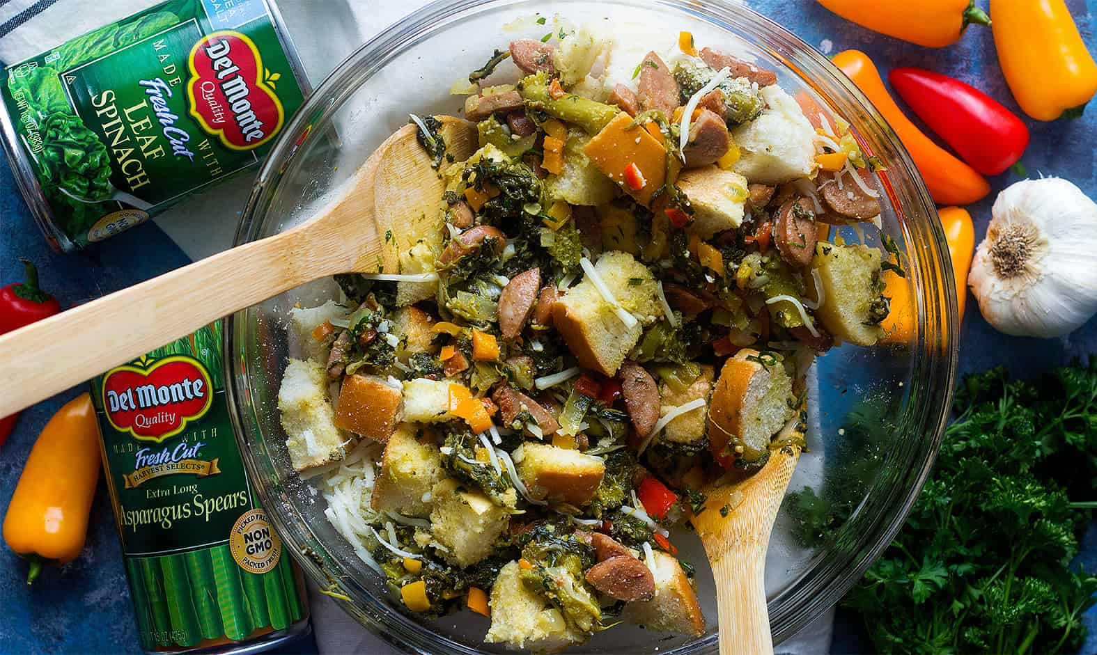 Mix bread cubes with vegetables in a large bowl to make bread pudding with sausage.