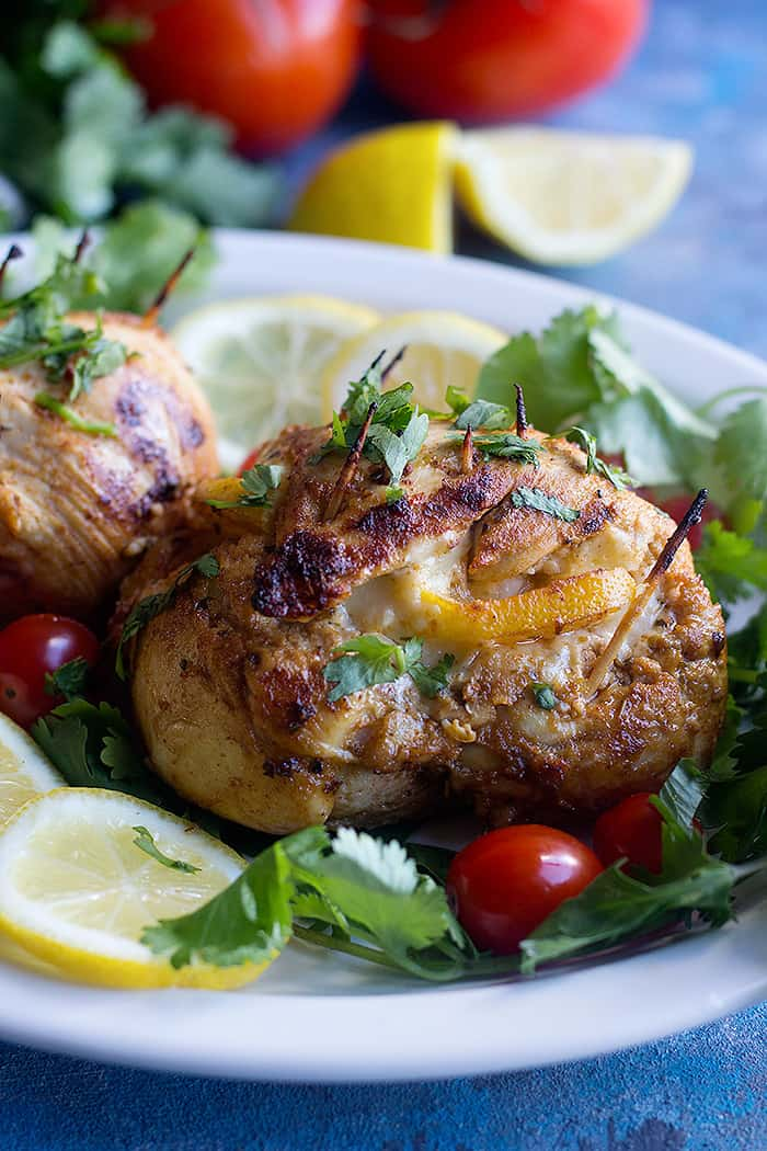 Cheese stuffed chicken breast makes a delicious dinner that's low carb and easy. Learn how to make these garlic lemon stuffed chicken breast at home with a few ingredients.