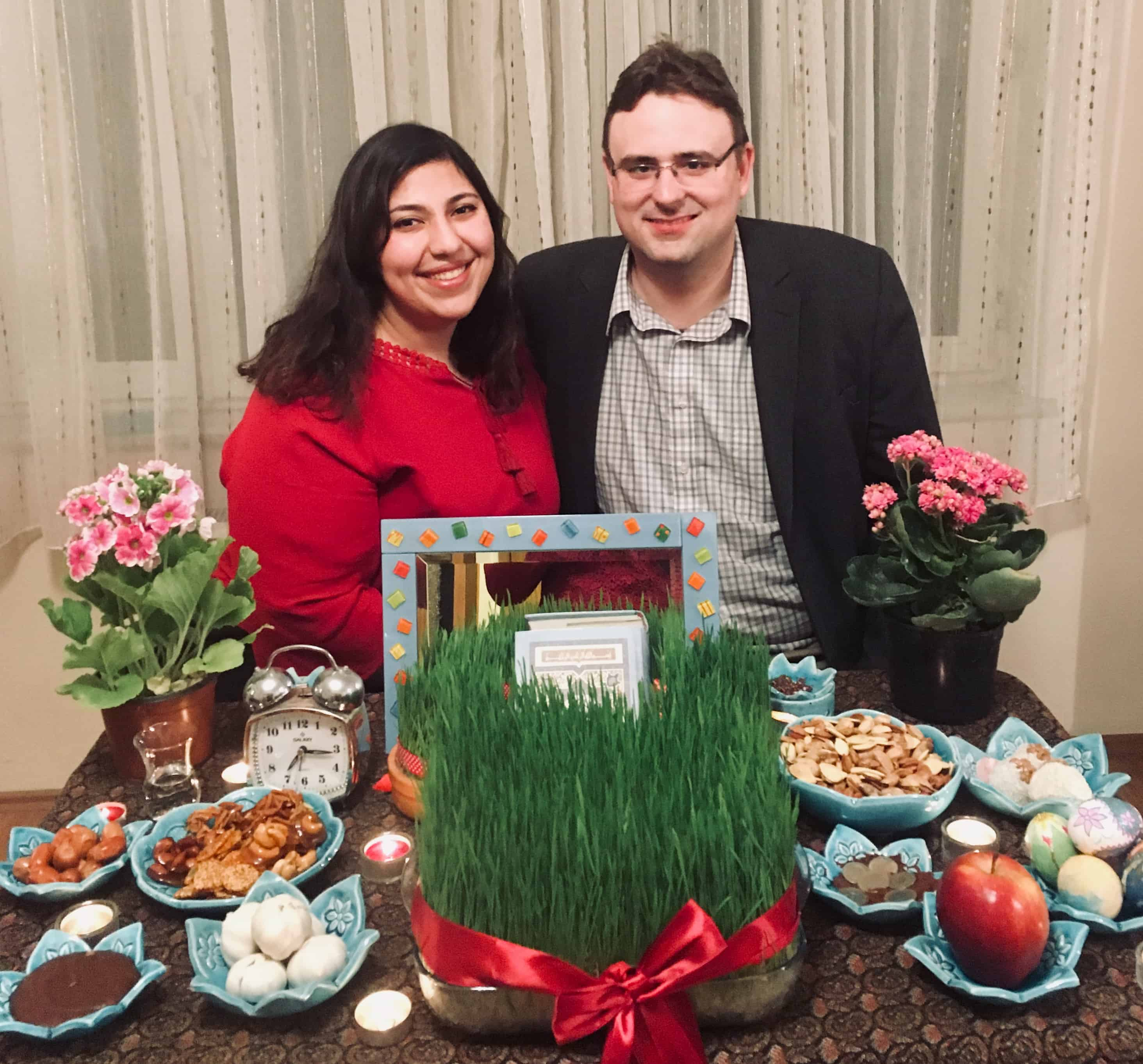 Families gather and set a table for nowruz.