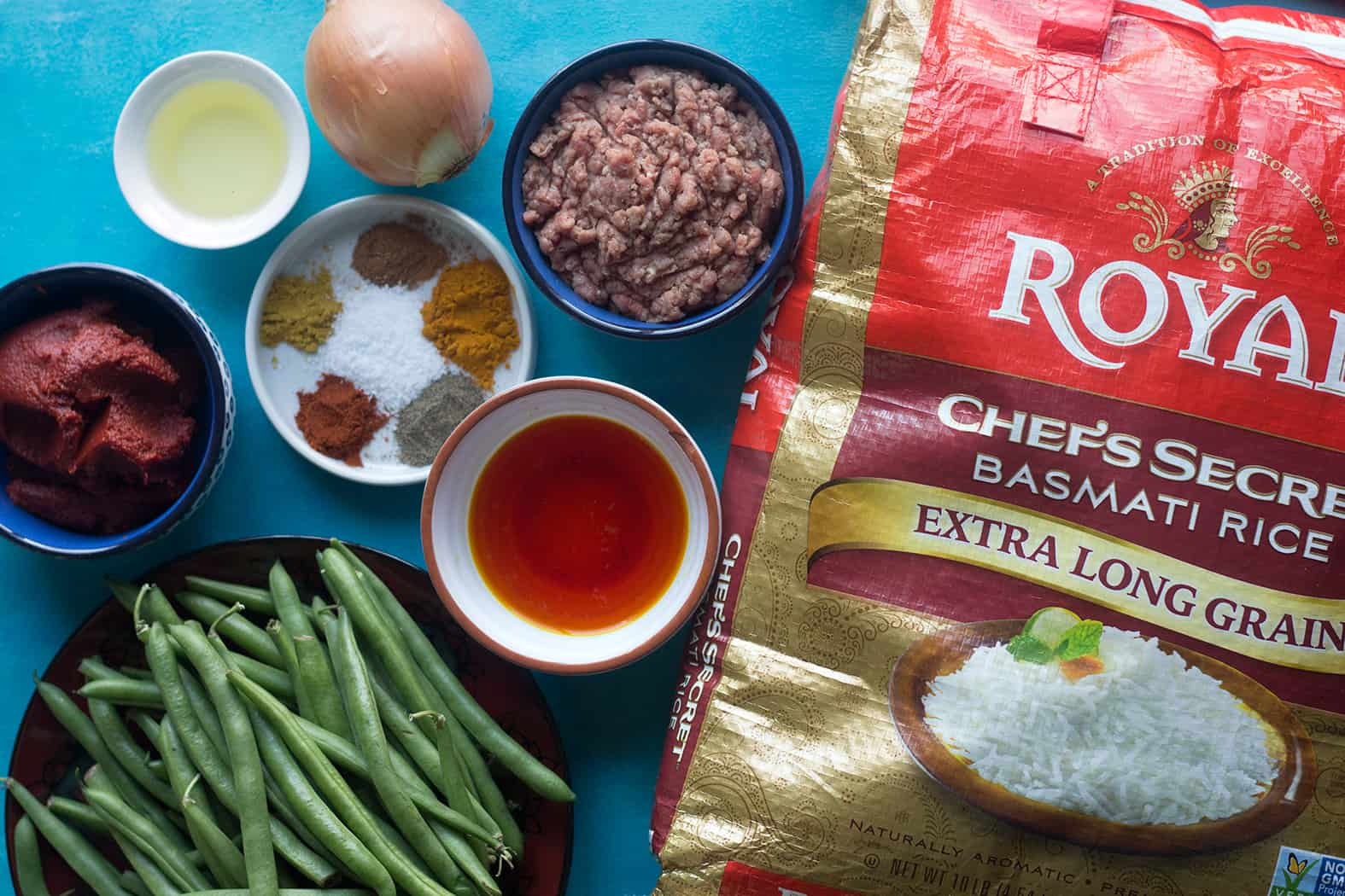 to make Persian loobia polo you need green beans, rice, ground beef, spices, saffron and onion.