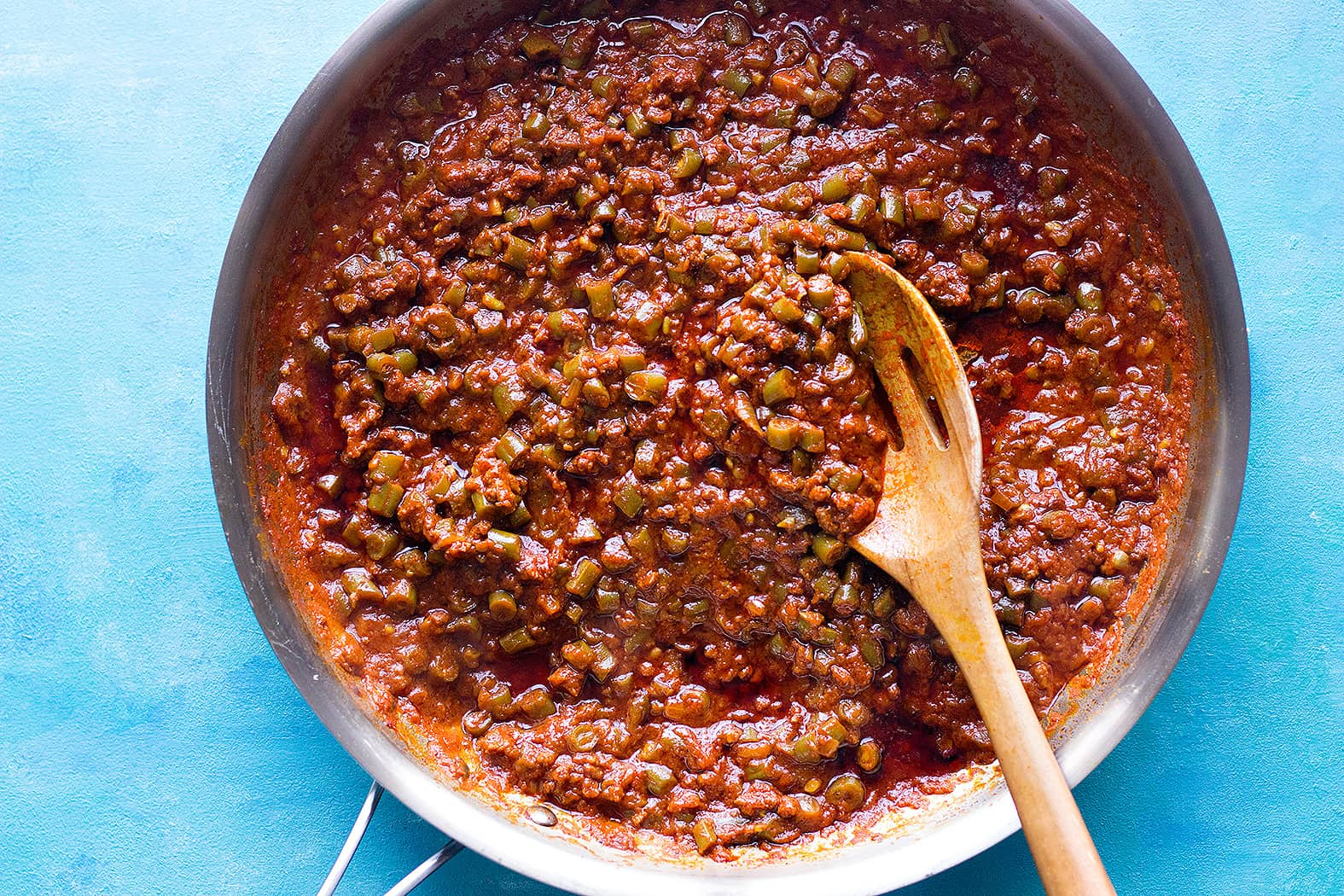 to make loobia polo filling, saute onion, beef and spices add tomato paste and water and beans. Cook completely.