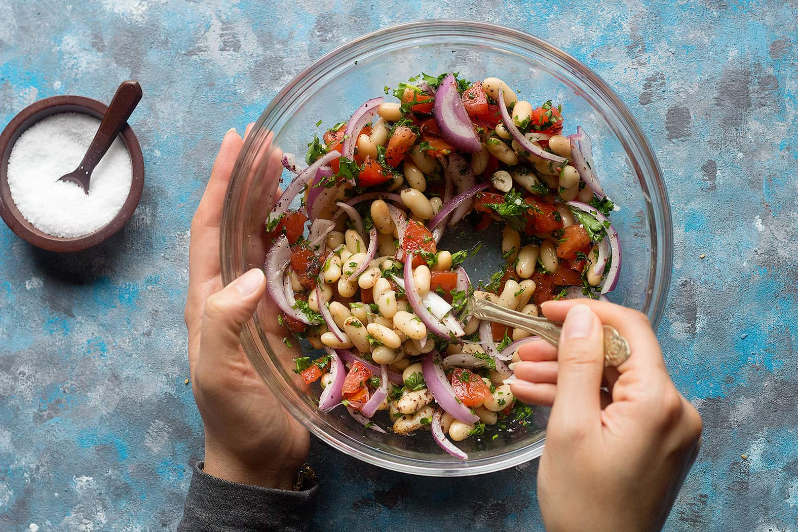Mix white bean salad with sumac lemon olive oil salt.