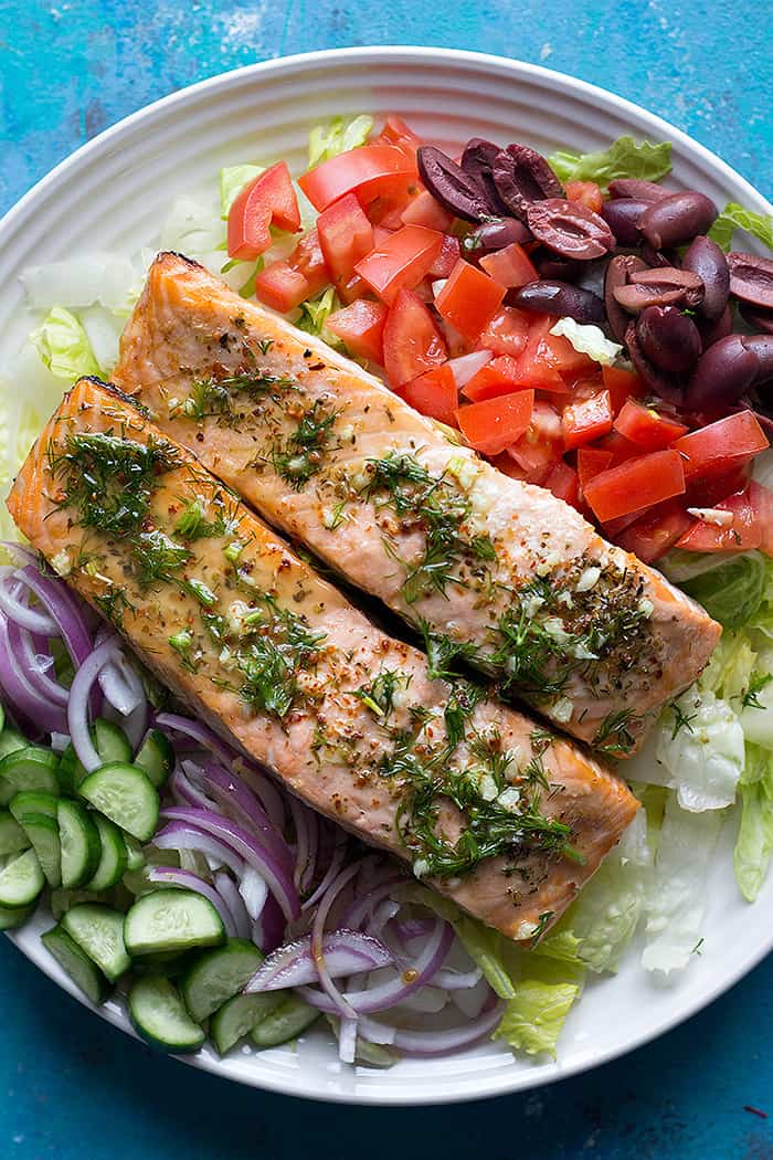 salmon salad made Greek style by adding kalamata olives and dill.