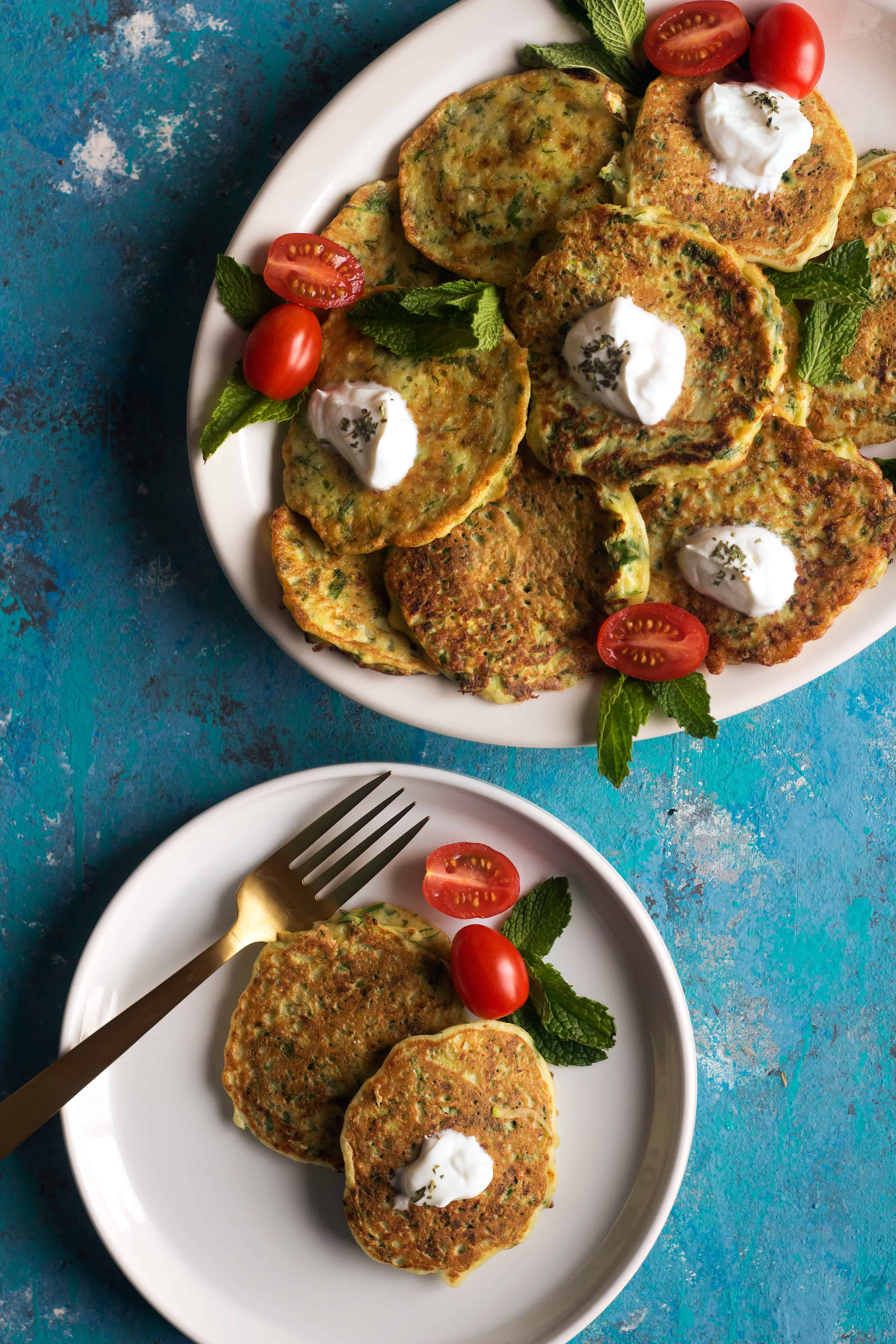 Mucver or zucchini fritters is a classic Turkish dish. This zucchini fritters recipe calls for fresh zucchini and herbs and it's very simple to make.
