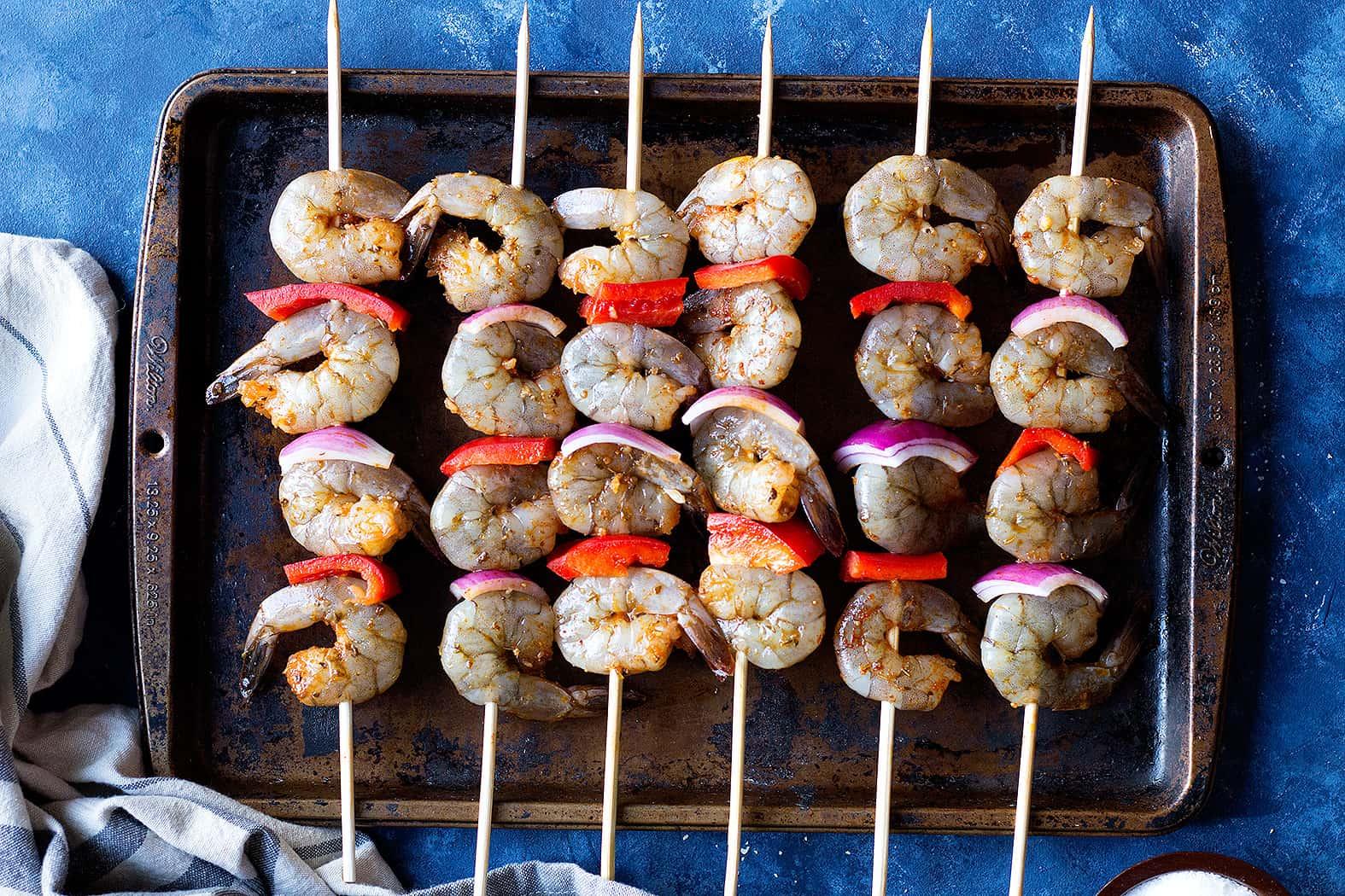 thread marinated shrimp onto skewers