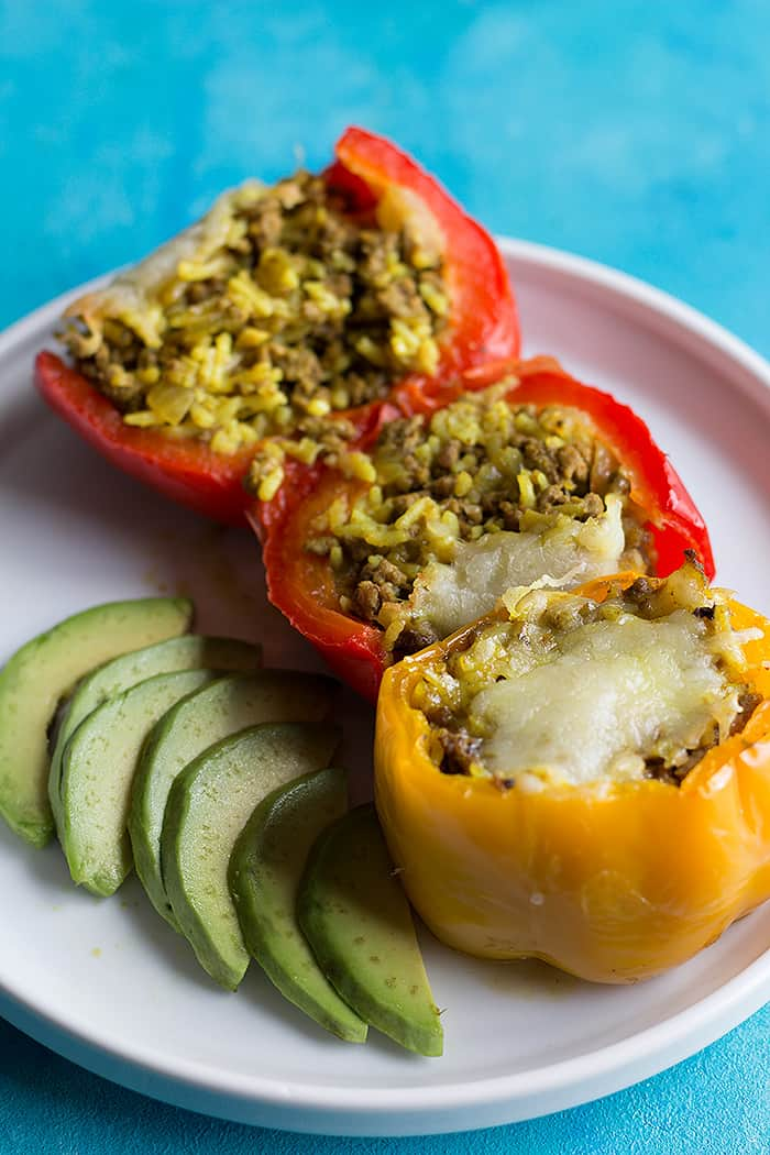 Mexican stuffed peppers are the perfect dinner. Colorful bell peppers are stuffed with delicious ground beef and rice filling that's bursting with flavor.