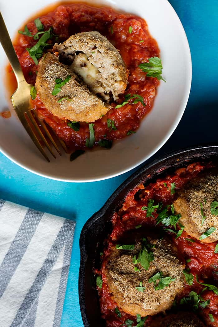 Eggplants meatball are perfect for dinner. These vegetarian meatballs are cooked in a chunky tomato sauce and are stuffed with cheese.