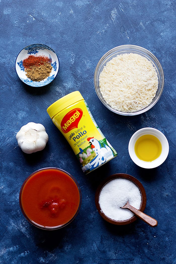 Ingredients to make arroz rojo are rice, garlic, olive oil spices and tomato sauce