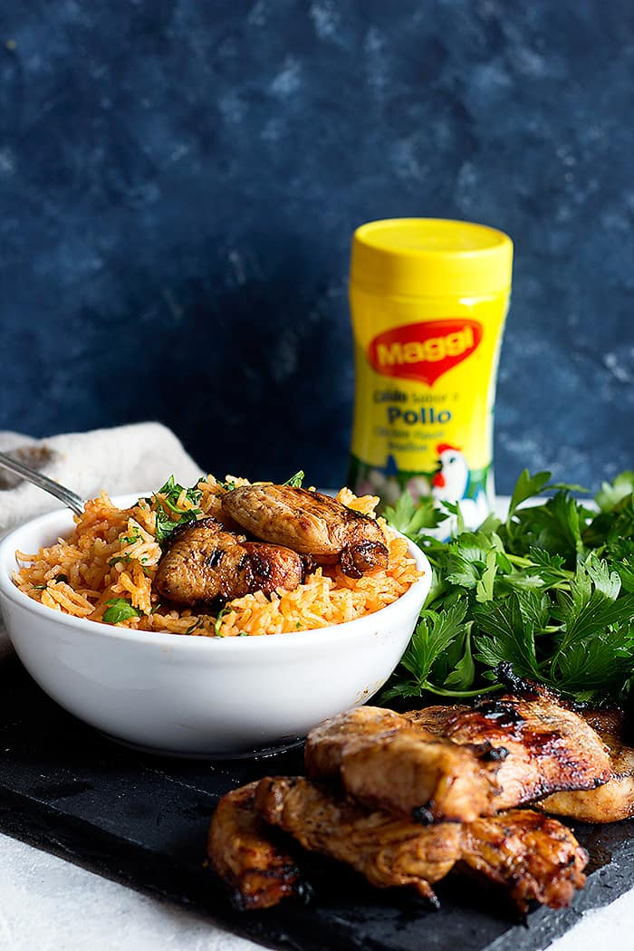 Mexican red rice made with tomato sauce and served with grilled chicken.