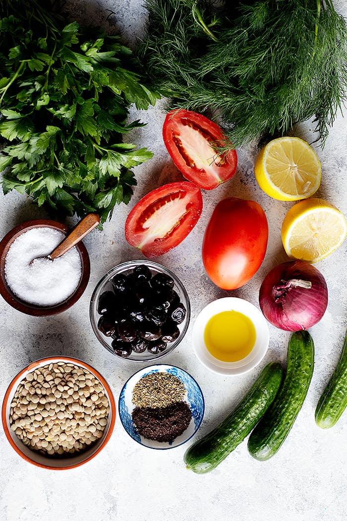 Ingredients shot contains herbs, salt, olives, lemon, onion, tomatoes, lentils, cucumbers and spices.