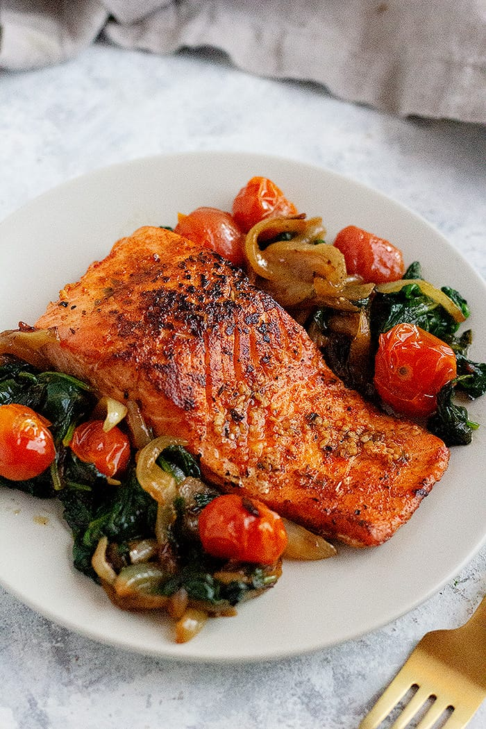 Everything you need to know about pan seared salmon. From what salmon to get to a fool proof how-to. Watch the step-by-step video tutorial to learn how to make the best pan seared salmon that's crispy on the outside and juicy on the inside.