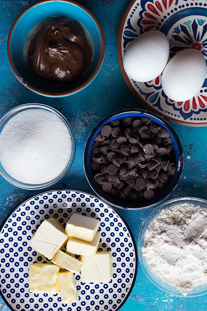 To make nutella filled brownies you need eggs, butter, chocolate chips, sugar, nutella and flour.