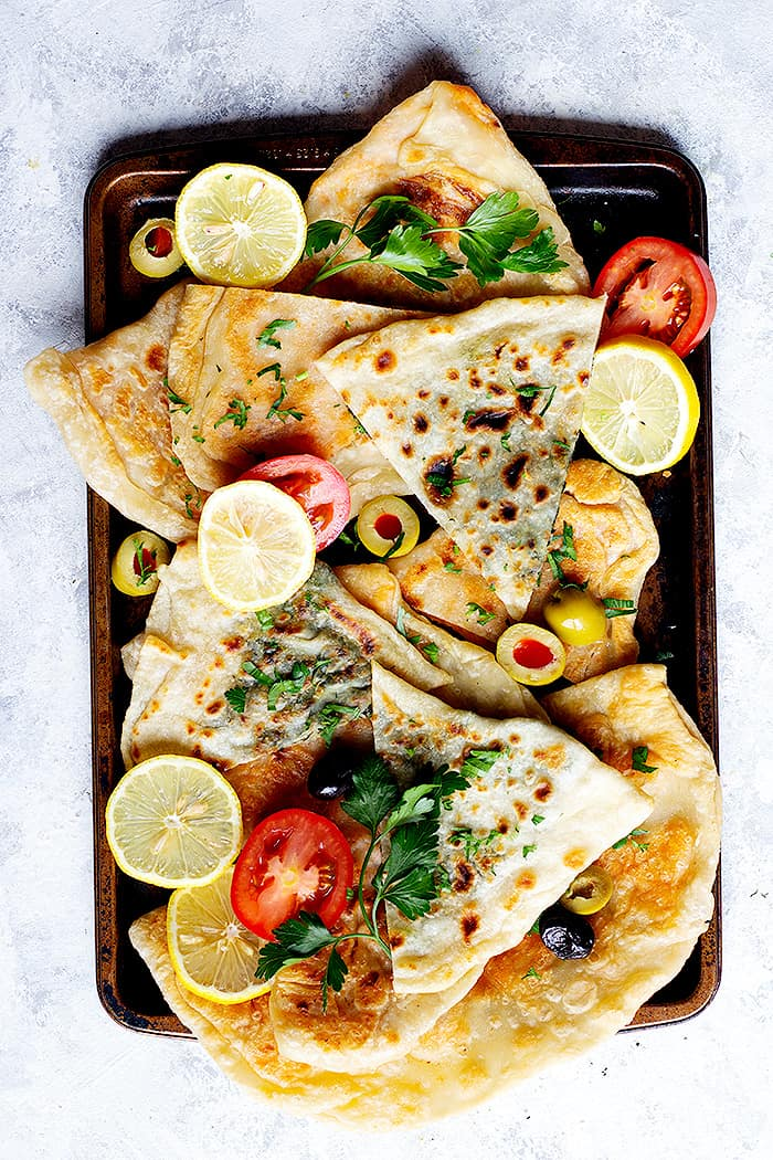 Cut turkish flatbread gozleme into triangles for better grab.