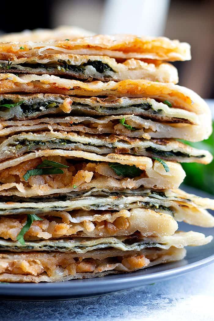 Gozleme can be made with different fillings such as spinach and potatoes.