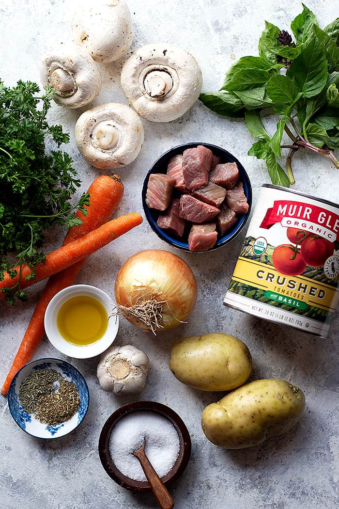 To make beef stew you need beef, mushrooms, tomatoes, carrots, onion, tomatoes and basil.