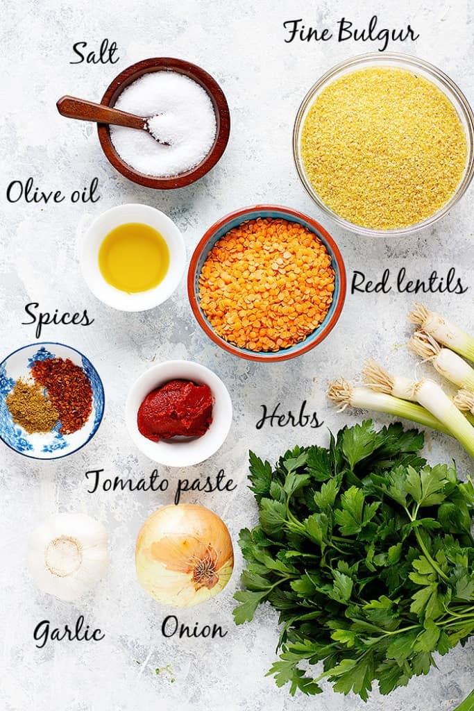 To make Mercimek koftesi (Turkish lentil balls), you need red lentils, bulgur, salt, olive oil, spices, tomato paste, herbs, onion and garlic.