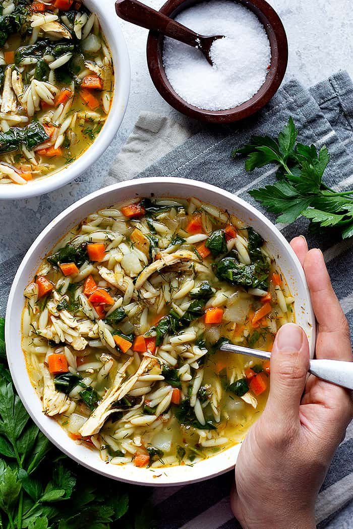 An easy and tasty lemon chicken orzo soup recipe that's lemony and so fresh. This chicken orzo soup doesn't use any cream and is so tasty!