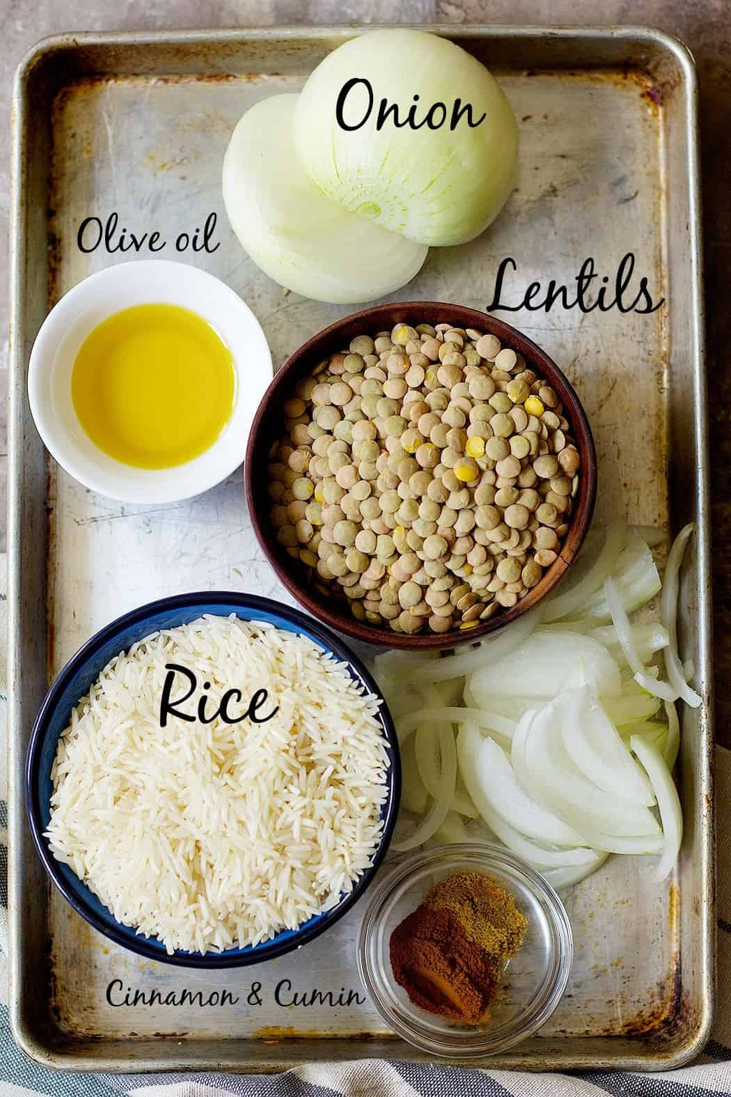 Ingredients to make Lebanese rice and lentils are rice, lentils, onion, olive oil, cinnamon and cumin.