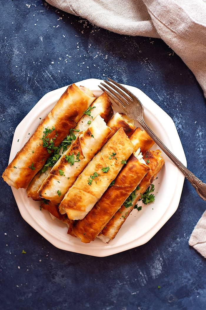 A plate of fried turkish cheese rolls also know as sigara borek.