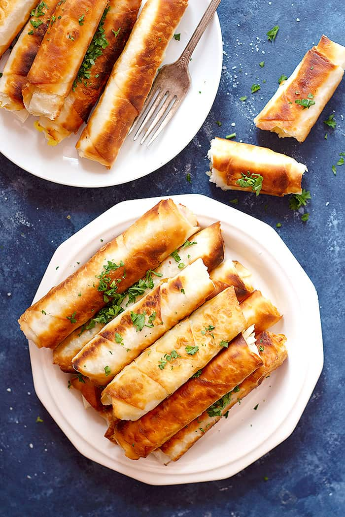 Borek is a Turkish savory crunchy pastry filled with different fillings such as cheese or potatoes. Learn how to make Turkish borek recipe by watching our step-by-step video and tutorial. They are perfect as a midday snack or for breakfast and you can make them in advance and freeze them for later.
