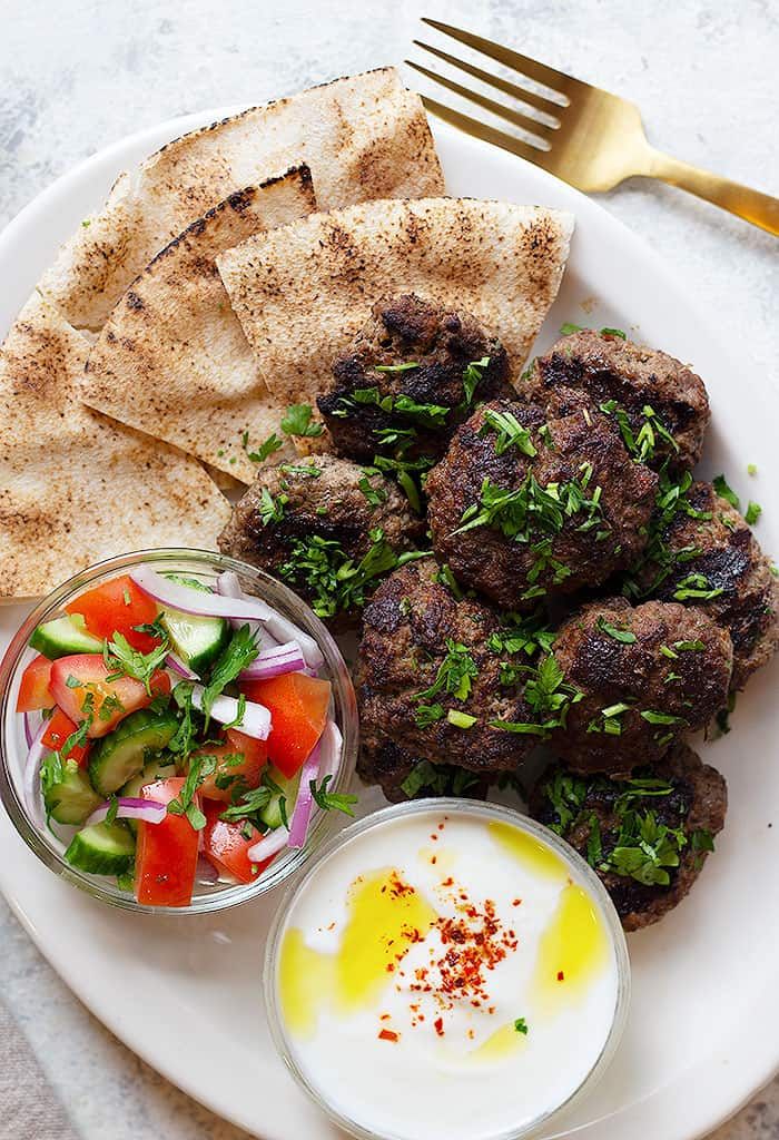 Kofta kebab is a tasty Middle Eastern ground beef meatball recipe that's packed with so much flavor. Learn how to make kofta kebab recipe with step by step tutorial and video.
