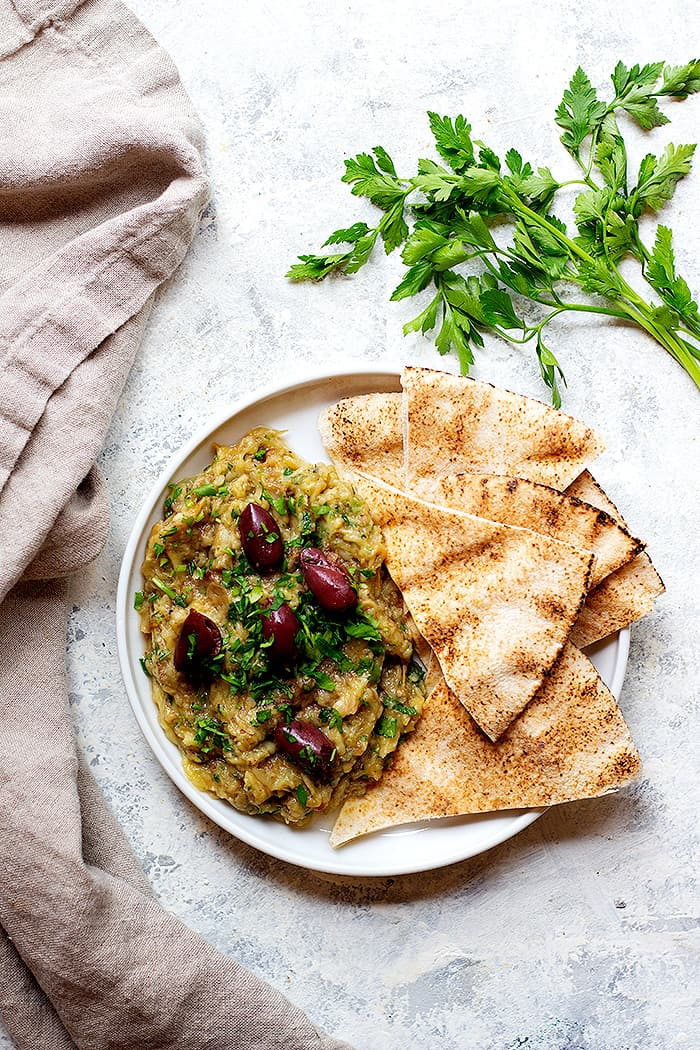 Melitzanosalata is a Greek eggplant dip that's made with eggplant, garlic and lemon juice. You can serve this eggplant appetizer as a part of a mezze platter with some pita.
