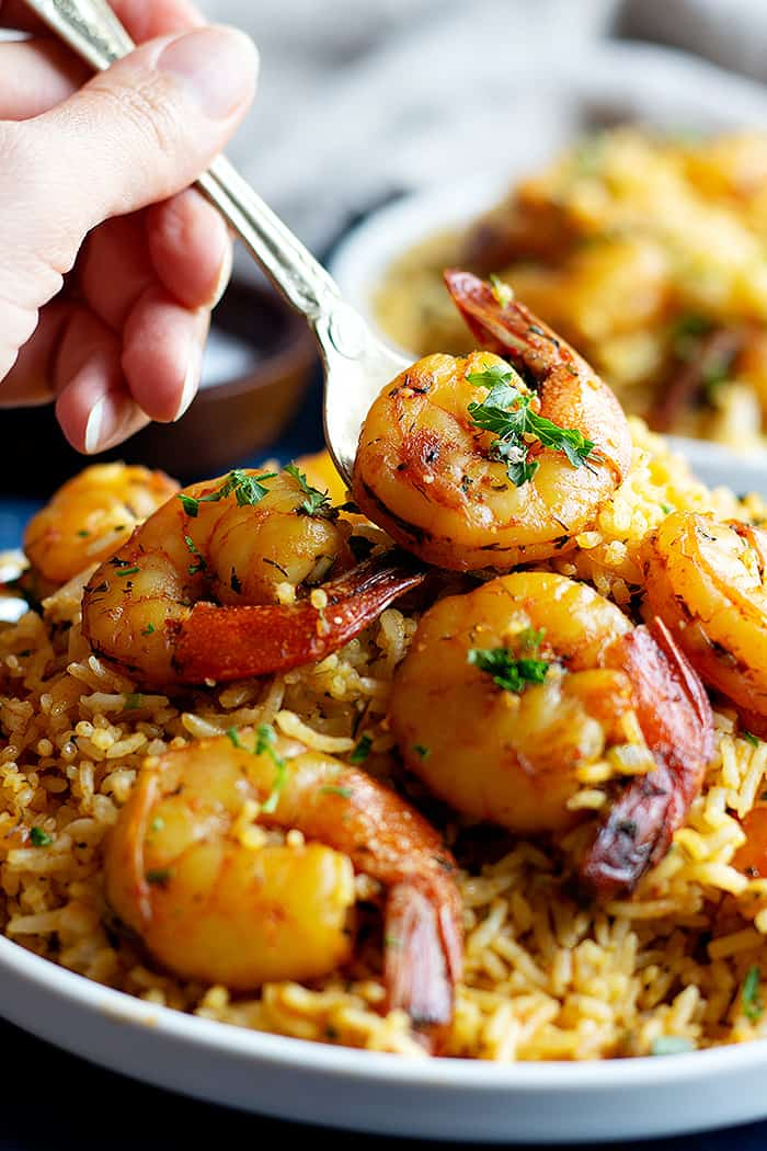 The good old shrimp and rice recipe made with a Persian twist. It's the perfect weeknight dinner made in a short time with fresh ingredients. This dish is packed with delicious and warm middle eastern spices!