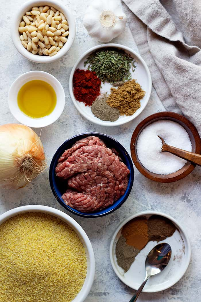 Ingredients to make kibie are ground beef, bulgur, onion, spices, salt, onion and olive oil.
