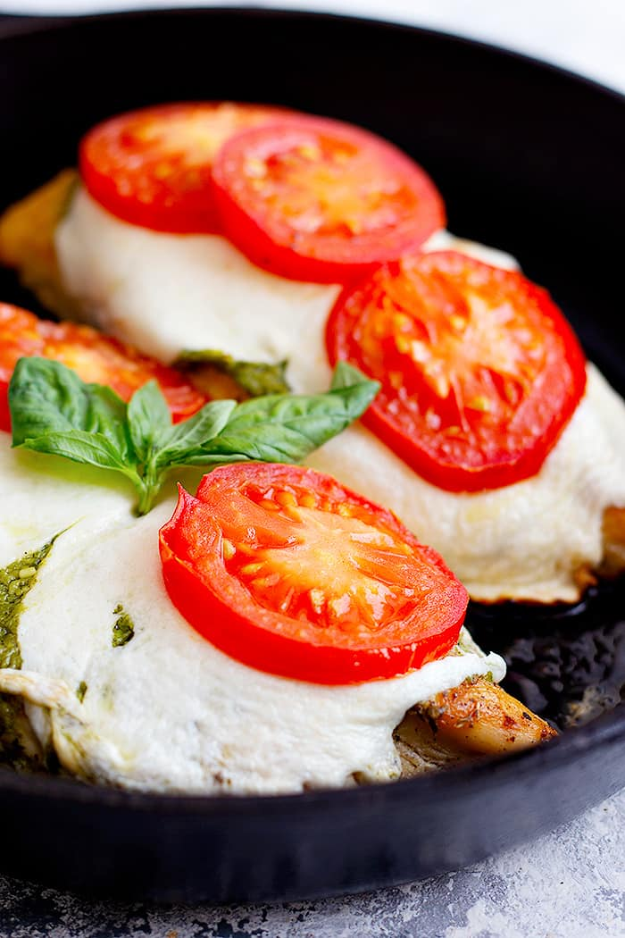 Easy caprese chicken recipe that's ready in only 30 minutes. Made with fresh tomatoes, mozzarella and pesto, this is a delicious easy weeknight dinner. Learn how to make this easy chicken recipe at home with our video and step-by-step tutorial.
