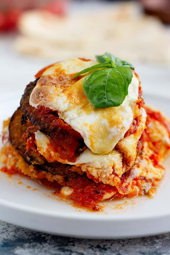 layers of fried eggplant with melted mozzarella cheese and tomatoes.