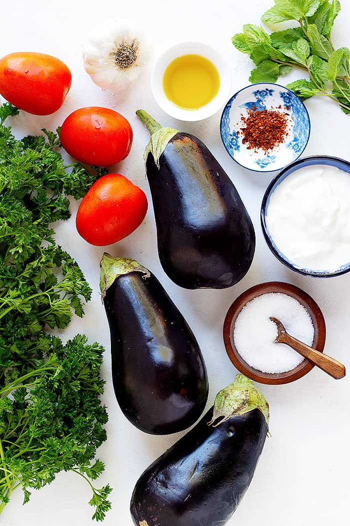 This recipe is made with simple ingredients such as eggplants, tomatoes, garlic, olive oil, salt, yogurt and herbs