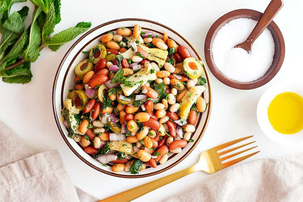 An easy three bean salad recipe with a Mediterranean twist. This protein-packed vegan salad is perfect for meal prep or as a side dish. Make sure to watch the video for step-by-step instructions.