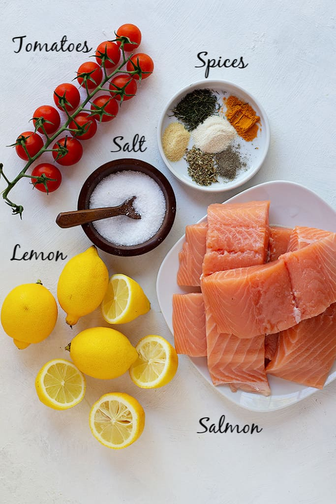 To make this recipe you need salmon, spices, salt, lemon and tomatoes.